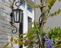 Climbing Wisteria softens and complements the architecture