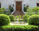 A raised pond re-inforces classical symmetry in the front entranceway
