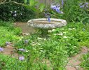 A small blue and white formal garden creates an additional 'room' within the main garden